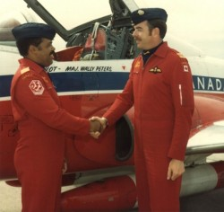 "obitoftheday:  Obit of the Day: Canada's First Black Jet Pilot Major Walter Peters joined the Royal Canadian Air Force after seeing a recruitment flyer. Major Peters, who figured if he could drive a car he could fly a plane, joined when he was 24 years old and was placed in the jet pilot program. He was the first black candidate in the RCAF program. The day before graduation he met a former pilot who had flown Mustangs in World War II. While listening to his stories, the stranger turned to Major Peters and asked him what he was doing there. When Major Peters informed the gentleman that he was graduating as a pilot the veteran replied, ""In my day you never would have gotten past rear gunner."" The following day Major Peters received the highest marks of any pilot in the class and went up to the podium to receive his award - from the veteran who had belittled him a day earlier. The major would have a stellar career in the RCAF. He not only served as a training officer but received appointments as and adviser to the United Nations Security Council and the first human rights officer in the Canadian military. He was also the first black member of the Snowbirds, the RCAF's precision flying team.  Major Peters, who had classmates refuse to room with him in college because of his race, passed away on February 24, 2013 at the age of 76. Sources: Toronto Globe and Mail and Veterans Affairs Canada (Image of Major Peters standing in front of his Snowbird shaking hands with an unidentified officer is copyright of RCAF and courtesy of www.45enord.ca) Also check out Lois Doyle, ""The Mother of the Snowbirds"" and Daurene Lewis, Canada's First Black Woman Mayor"