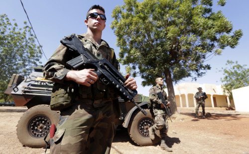 "Photo: French soldiers stand guard at a Malian air force base near Bamako on January 18, 2013. (Eric Gaillard/Reuters)  A Malian Quagmire? In Defense of French Intervention. By David Rohde  In any crisis, western military intervention should be treated as a last resort. But in the Sahel, the price of passivity would have been unacceptably high. The question from a colleague — one whose work I admire — could have come from anyone in the United States. ""So the French,"" he asked, ""now have their own Afghanistan?"" The answer is yes and no. Western military interventions should be carried out only as a last resort. But Mali today is a legitimate place to act. Several thousand jihadists threaten to destabilize Mali, Niger, Nigeria, and Algeria. Beyond the human rights abuses, their attacks will discourage foreign investment, paralyze local economies and produce vast numbers of refugees. Skeptics play down the threat, but the instability these extremists create will spread over time. The tragic kidnapping in Algeria, where many hostages appear to have died in a botched rescue attempt today, is already prompting oil companies to pull foreign workers out of the region. Islamists can't be ignored and won't disappear. They should be confronted or contained. The question is how. To ensure that Mali is not another Afghanistan, it is vital that France and the international community have reliable allies on the ground. They should mount diplomatic and economic efforts ‑ not just lethal force ‑ against the jihadists as well. Many commentators immediately dismissed France's intervention. Some denounced it as ""militarism."" Others declared it ""neo-colonialism."" The most common phrase was ""quagmire."" In Washington, even some Obama administration officials played down the threat that Mali represented, arguing that Western troops may have made things worse. Isolationism is politically easy but the wrong course. No American ground troops should be deployed, but the Obama administration should assist the French with logistics and intelligence support.  Lost in the so-far skeptical response to the intervention is a clear truth on the ground. For now, public opinion in Mali and across West Africa is hugely supportive of the French intervention. Press reports indicate that before the French arrived, the 1.8 million people of Bamako, Mali's capital, were increasingly terrified that Islamists would take the city. ""People have started to smoke cigarettes and wear long pants!"" one taxi driver declared after France intervened. ""They're playing soccer in the streets!"" From a military standpoint, the French had to act. More than 8,000 French citizens live in Mali, many of them in Bamako. And last week militant groups were on the verge of seizing a militarily vital airfield in the town of Sevare. Had the field been overrun, it would have been enormously difficult for troops from France or a UN-mandated West African force to have moved into Mali. Gregory Mann, a Columbia University history professor and an expert on Mali, has written the bestanalysis I have found of the intervention. The crisis ""needs diplomatic intervention every bit as urgently as it needed military intervention,"" he argues.  ""Mali's troubles come largely from beyond the country's borders, as do most of the jihadi fighters,"" Mann told me in an email message. ""It will take a coalition of countries to confront them, and building and maintaining such a coalition should be the diplomats' first priority."" Fears of a quagmire are understandable. The problems that have plagued Mali in recent years after decades of stability sound familiar: government corruption, ethnic and separatist tensions, drug trafficking, meddling neighbors and increasingly weak national institutions, particularly the army. A previous American effort to train the Malian army to fight Islamists failed spectacularly. And the French intervention is likely to spark retaliatory attacks like the seizure of dozens of foreign hostages in Algeria on Wednesday. Post-Iraq and Afghanistan, skepticism about any Western military intervention is healthy. And France's record of intervention ‑ from Algeria to Vietnam ‑ is poor. But Malians are calling for help, and a UN effort to counter the militants has stalled. The Islamist fighters have taken control of northern Mali with surprising speed, are well organized, heavily armed and in control of a desert area the size of France. Their fighters include members of al Qaeda in the Islamic Magreb, a North Africa-based group allied with al Qaeda. In the future, they could easily use Mali as a base to carry out attacks in France and Europe. Until now, the group has not said it intends to carry out attacks in the United States, but members of the groups are believed to have been involved in the murder of the American ambassador to Libya, Chris Stevens, and three other Americans. They have also amassed an estimated $100 million by kidnapping Westerners and demanding enormous ransoms.  Robert Fowler, a Canadian diplomat who was kidnapped by the group in 2009, said his captors told him their hope was to create an Islamic emirate that spanned Africa. Their goal was to spread chaos from the Atlantic to the Pacific. ""They would tell me repeatedly that their objective was to extend the chaos of Somalia across the Sahel to the Atlantic coast,"" Fowler said in a telephone interview Wednesday. ""They believed that in that chaos their jihad would thrive."" My perspective is not neutral. Four years ago two Afghan colleagues and I were kidnapped by the Taliban and held captive for seven months in Pakistan. I saw their brutality, ignorance and determination first-hand. I believe economic growth is the best way to counter militancy, not massive Western military interventions. To me, a threat exists from militancy, it is not manufactured. Yet we declare that there is no threat or grow impatient when it is not quickly solved. France faces months of casualties and conflict, but that should be expected. Quick solutions are illusory. So are claims that we can ignore violent militants. Countering militancy involves a combination of limited military force, expansive diplomacy and patience. We rarely show those qualities. I hope the French do.    This post also appears at Reuters.com.  David Rohde is a columnist for Reuters, two-time winner of the Pulitzer Prize, and a former reporter for The New York Times. His forthcoming book, Beyond War: Reimagining American Influence in a New Middle East will be published in April 2013. More"