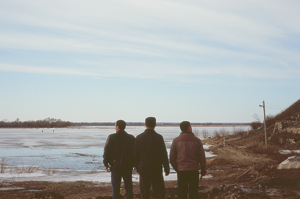 3 men looking  Tatarstan, Russia April 2013