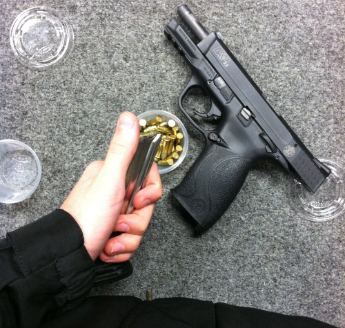 iamjamesdeen:  Grey glock  Why does that Glock say Smith and Wesson on the side? Is this the rare Glock and Wesson FAMAS .50 AE handcannon? and is that an assault clip?