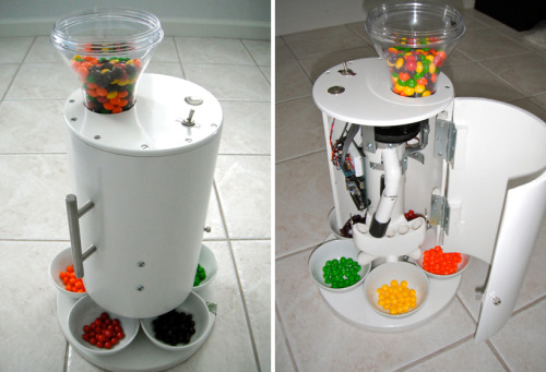 """…the one-off machine automates the sorting of Skittles, M&Ms, and Reese's Pieces into colored categories. Candy is automatically dispensed into separate bowls at the bottom, which can be accessed as easily as any candy dish.""   (via skittles sorting machine by brian egenriether)"