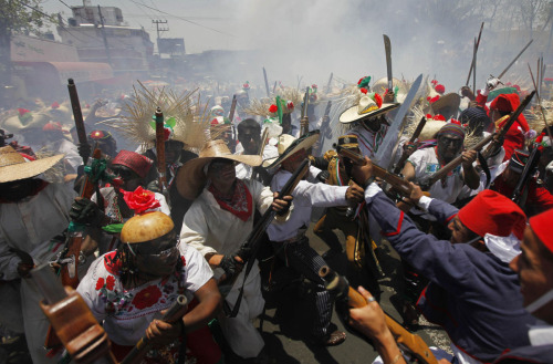 Mexicans recreate the Battle of Puebla during Cinco de Mayo celebrations in Mexico City on May 5, 2010. On May 5, 1862, Mexican forces loyal to Benito Juarez defeated French troops sent by Napoleon III in the Battle of Puebla in Mexico. Photo by Eduardo Verdugo. (Baltimore Sun)
