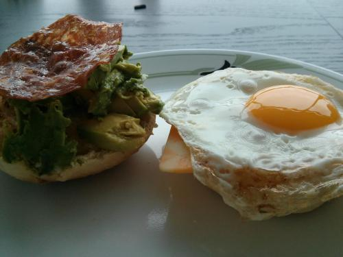gastropost:  From Gastroposter Joanne Sequeira:   We love brunch in my household! In fact, many dates have been had with my new fiancee at the best (and worst) brunch spots in Toronto. But no matter where we go, a homemade brunch is the best. This brunch sandwich features: marbled cheddar, a fried egg, fried salami and avocado on a homemade hamburger bun.  Really nice!!