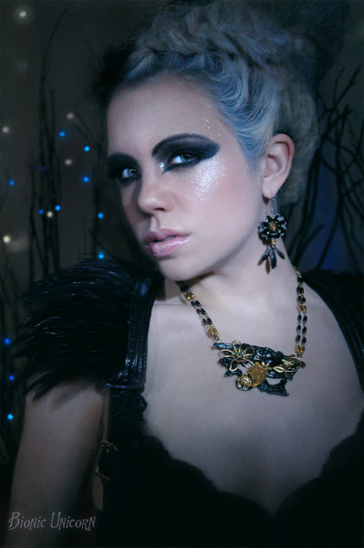Jewelry and Photography by Bionic UnicornLeather Harness by The Artificer's Aethernautical EmporiumSpecial thanks to Amber Rose Hair + Makeup Starring Cristina Peterson