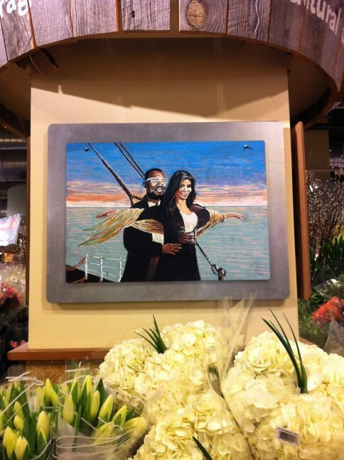 perpetua:  This Kanye/Kim Kardashian/Titanic painting is hung above the flowers at a Whole Foods in Manhattan. Amy Odell found it, and it is amazing.