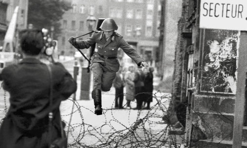 collectivehistory:  East German soldier Conrad Schumann escapes from East Germany by jumping over the early construction of the Berlin Wall to West Germany, 1961.