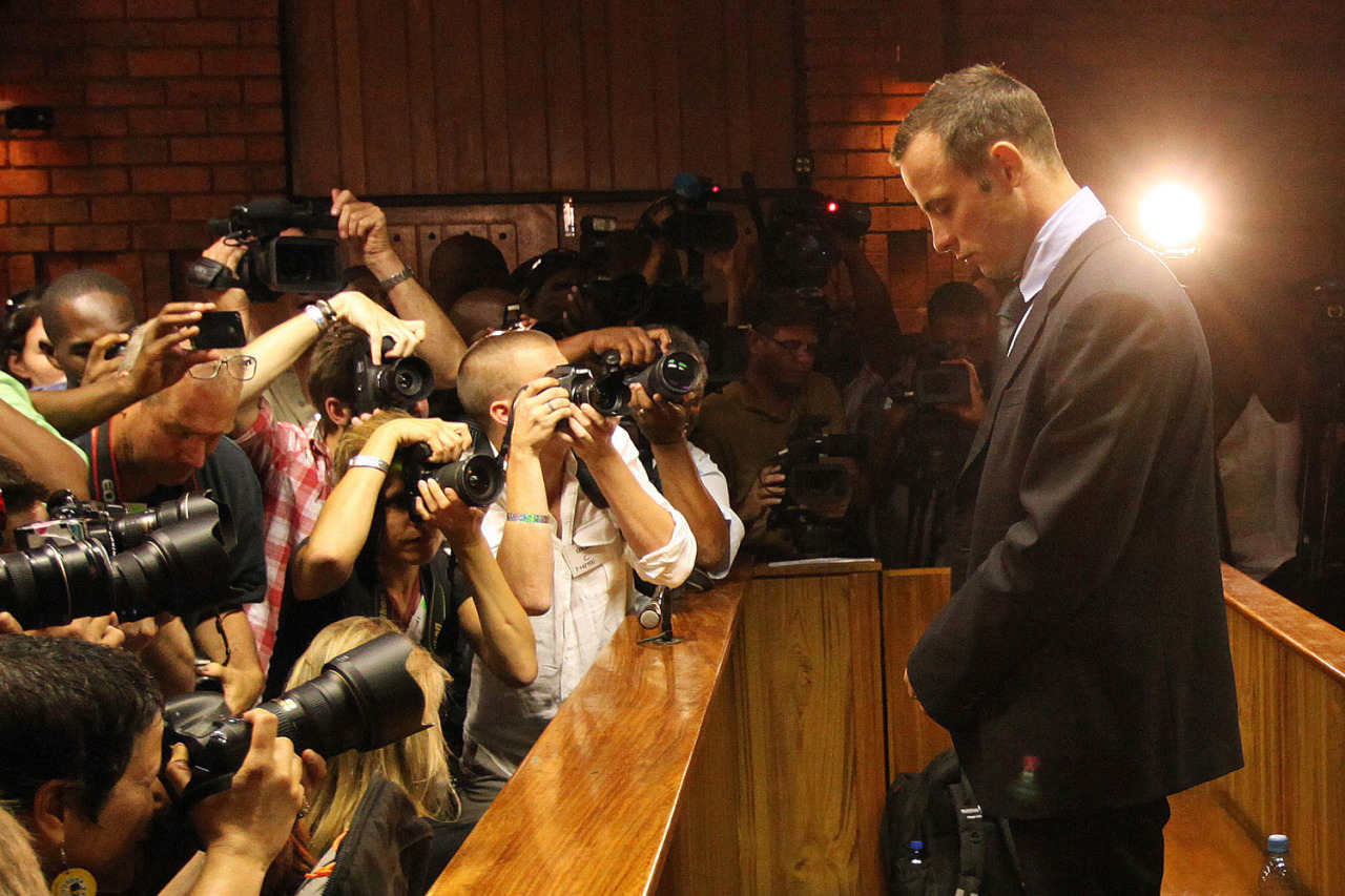 This is an intense photo of Oscar Pistorius on the stand during his bail hearing. The photographer did an amazing job in including the other photographers in the shot rather than just getting a shot of Pistorius. Can you imagine what must have been running through his head at this moment?? Can you imagine having all of those cameras right there in your face?? There is no hiding from that. A really great image from Themba Hadebe-AP and a big thanks to Time Lightbox for sharing it. -zps timelightbox:  Themba Hadebe—AP From female fighters in Syria and smugglers under Gaza to the second anniversary of Libya's uprising and a 100-year-old hospital for dolls, TIME presents the best images of the week.  Feb. 22, 2013. Photographers take photos of Olympic athlete Oscar Pistorius as he stands in the dock during his bail hearing at the magistrates court in Pretoria, South Africa.