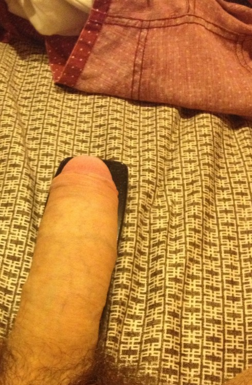Semi hard, resting on a comcast remote. big and thick uncut cock!