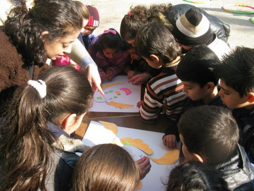 "unicef:  Children of Syria: Witnessing Pockets of Hope in the Midst of TurmoilBy Mark Choonoo - Emergency Specialist, UNICEF Middle East and North Africa The following op-ed was published in the Huffington Post on 7 February 2013. I have just completed a mission to Homs where I stayed for one month as part of a mission to assess the humanitarian situation in the governorate, review our programmes and to strengthen and build our relationship with local partners. Almost one in three persons in Homs is a displaced person, our partners on the ground tell us, and according to them, two thirds of the displaced population are children. Explosions, the sound of shells landing and the crack of gunfire are all part of the day-to-day life here. Less than a kilometre from the hotel where I was staying, fighting raged on with a ferocity that shakes the city. Even after 20 years of doing this type of work in some very dangerous areas of the world, every explosion still made me worry. Amid this, we as a humanitarian team had to keep focused on how to improve the lives of those affected by this two-year long crisis. I walked around to see how children in Homs are living. In a convent that works with children, situated at the end of a line of fully standing buildings and right before the destruction and rubble begins, I was amazed to find children reading books, listening to teachers, drawing pictures and playing games. The drawings on the walls spoke of smiling faces, waving hands, laughter and messages about the need to forgive. A total contrast to the rubble outside that represents so many battered lives. I also went to what is called the ""towers"" which are unfinished blocks of apartments turned into collective shelters for displaced families. There, I met a 14-year-old girl and her younger brother who have literally opened a classroom on their own for themselves and their peers. The two siblings, whose schooling was disrupted because of the conflict, have transformed their shelter into a learning space where children come to study text books together. The common message I got from parents and all education practitioners I met was the need to make sure that children can continue their schooling. A significant part of the education infrastructure in Homs has been severely affected by the conflict, with many schools either damaged, or turned into shelters for displaced families. Naturally, this is putting enormous pressure on classrooms that are still functioning and on teachers who are challenged to do more than their best to teach double and triple the size of their normal class. Unicef is working with partners to provide remedial learning programmes to help more children continue their education. About 6,500 children benefited from this programme in Homs so far and we are working to reach more children in the coming weeks. We will also soon be providing formal schools in Homs with essential school supplies to allow more children to enrol and improve the quality of education. In Homs, I saw and heard about much suffering and desperation, but I also encountered amazing stories of people who, in the midst of all this, are doing everything they can to cope with their circumstances and create pockets of hope in a world of chaos. Our partner in Talbiseh town, in Homs Governorate, told us how women are coping with the shortage of clothes, in this harsh winter, by turning blankets donated to them into clothes. We are providing winter supplies and non-food items for affected families, including packages of children's winter clothes. Unfortunately, because of the ever growing scale of the crisis, there's not enough to go around for every child. Our partner in Talbiseh described how they will unpack the content of the boxes of children's clothes that they receive from Unicef and distribute to mothers and children piece by piece, according to the need. ""So for instance, we will give shoes to a child who needs them and give pyjamas to another child who has shoes but no clothes."" During the last two weeks, Unicef relief supplies — which include family hygiene kits, blankets, quilts, food kits and high-energy biscuits for children — reached more than 67,200 people in Homs. I cannot imagine the fear a little child experiences with each shattering blast that rocks the city. Most children I saw were showing some signs of distress. This is why it is extremely important that we set up child friendly spaces and provide psychosocial support for as many children as possible. We met with some local organisations working on psychosocial projects to discuss how we can work together. They are groups of energetic young people who have never imagined that one day they would need to do such work in their own city. Given my experience as a counsellor, I was asked to help them set up a focus group of practitioners to help address the problem. If we had more resources, and strong partnerships, there is so much more that we could do. I realize more and more the fear that has crept into communities, and into children's lives. Our work in the area of psychosocial support will be extremely important to make sure that children can regain connection with their childhood, and grow up to become healthy members of their society. Follow Mark Choonoo on Twitter: www.twitter.com/UNICEFmena Photo caption: Children engage in fun activities in one of the UNICEF-supported recreational facilities in Homs.Photo credit: UNICEF/Syria2013/Mouaz Mahfouz"
