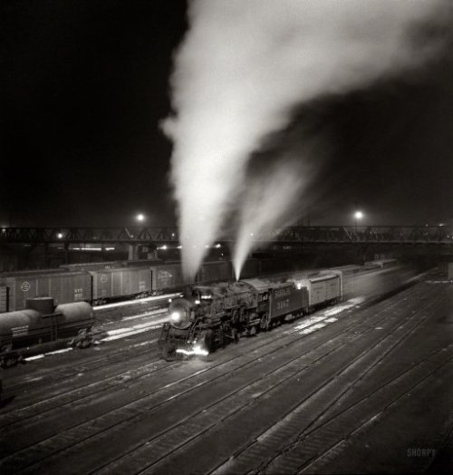 "mudwerks:  (via Midnight Special: 1943 | Shorpy Historical Photo Archive)  March 1943. Argentine, Kansas. ""Freight train about to leave the Atchison, Topeka & Santa Fe Railroad yard for the West Coast."" Medium-format nitrate negative by Jack Delano for the Office of War Information. View full size.   This is amazing."