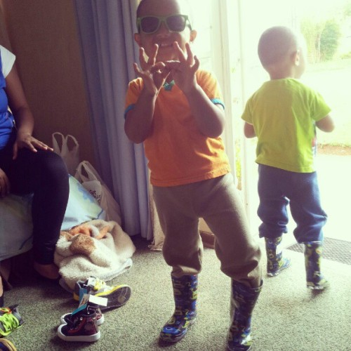 Keyaan and Miraj got new booties (cant believe they back in fashion for kids) check keyaans peace sign he feels couple of fingers is better than two #cute #family #nephews #coolest