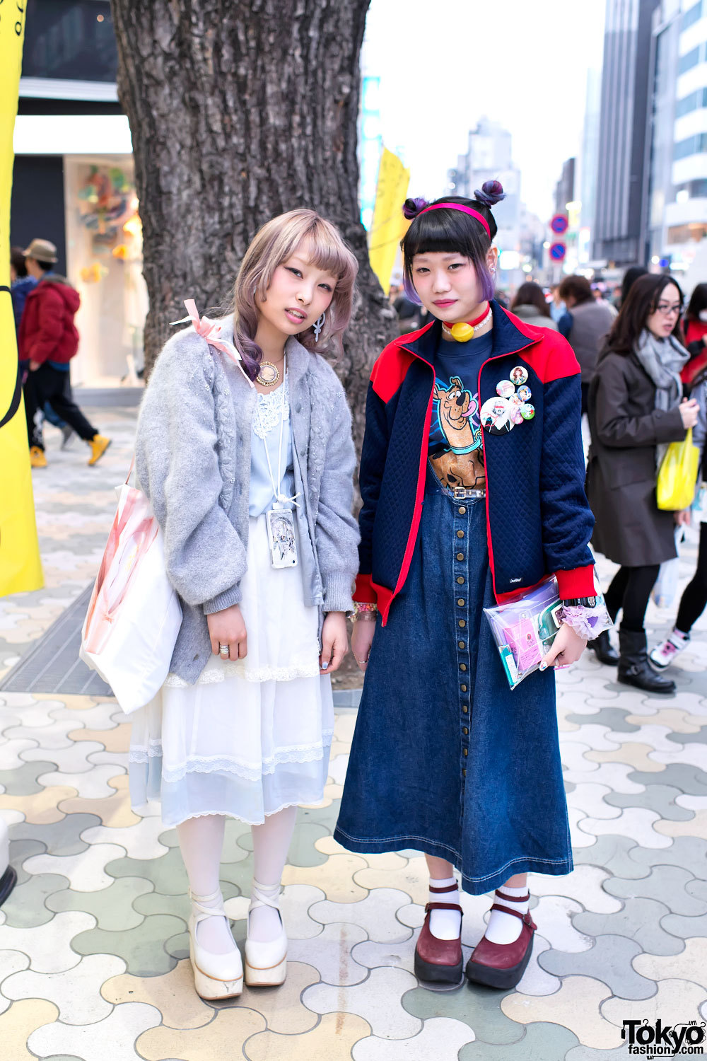tokyo-fashion:  Sofy w/ items from Syrup & Grimoire. Elleanor w/ Doraemon choker & Scooby Doo top. On the street in Harajuku.