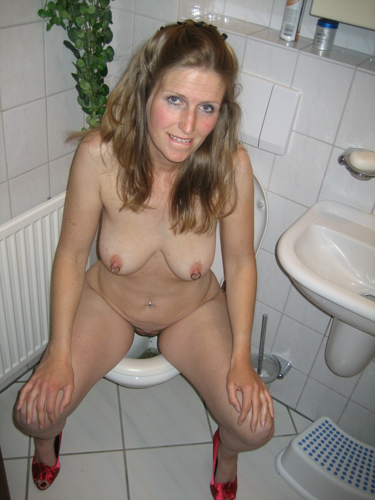 Mature toilet peeing
