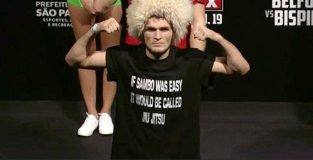 * Khabib Nurmagomedov is a Russian fighter who fights in UFC for 155lbs division. [Pic from UFC on FX 7 Weight-in in Sao Paulo, Brazil]  Gotta love crazy Russians doing their thangs. This pic had me dying lolol