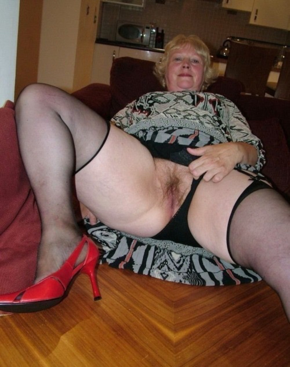granny  pussy ass Granny pulling aside her pantys and showing her lovely pussy