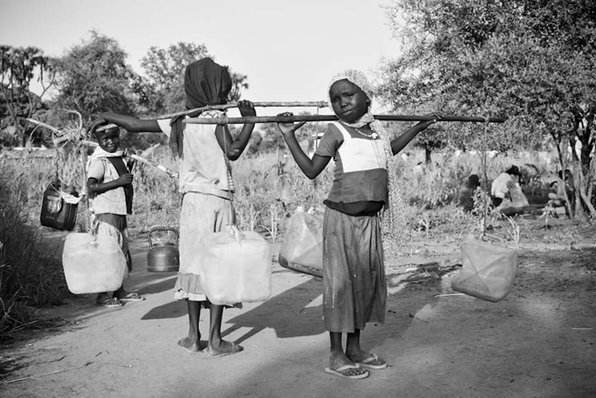 humanrightswatch:  Girls carrying water at the Doro refugee camp in Maban, Upper Nile state in South Sudan. Female refugees and humanitarian agencies say that the risk of physical and sexual assault while collecting water or firewood is one of the gravest safety ad security concerns faced by female refugees. According to the UNHCR, the United Nations refugee agency, girls (under 18) are 32 percent of the entire Blue Nile refugee population registered in the four camps in Upper Nile state, South Sudan. © 2012 Samer Muscati/Human Rights Watch