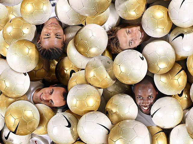 Landon Donovan (bottom, left) smiles in a soccer ball pit with teammates Oguchi Onyewu (top, left), Bobby Convey (top, right), and DeMarcus Beasley. (Simon Bruty/SI) GALLERY: Landon Donovan Classic Photos