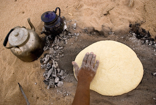 djazairi:   Tuareg bread  Traditionally baked in the hot sand and ash, washed afterwards and crushed into pieces to be eaten with sauce.