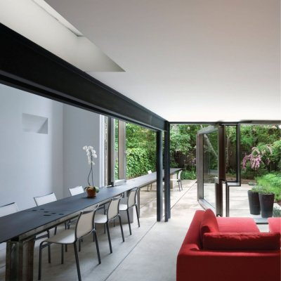 Operable Boundary Townhouse by Dean/Wolf Architects The relationship between the garden and the house fluctuates with the use of full height windows and flushed floor levels.