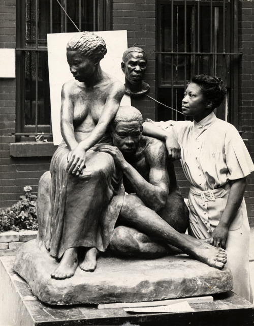 vintageblackbeauty:  Augusta Savage with one of her sculptures, ca. 1938. From the collection of the Archives of American Art