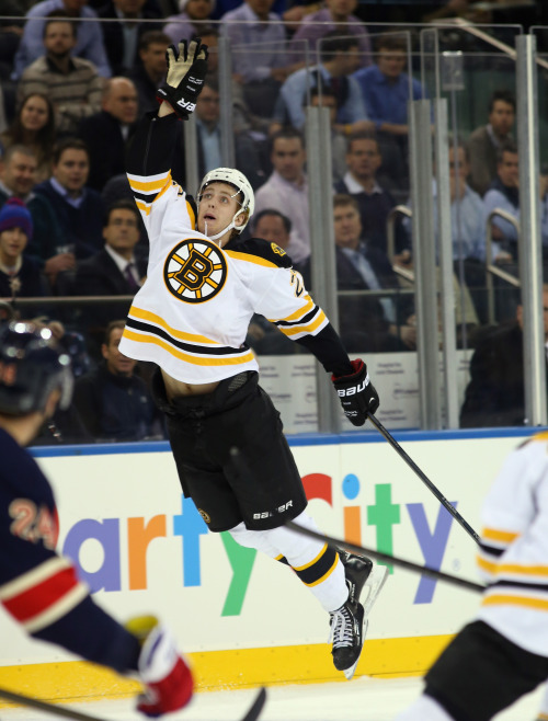 "Air Dougie! Going through photos from the Bruins' game in New York against the Rangers and this one of Dougie Hamilton ""jumped"" out at me… No. 27 with a huge reach to bat the puck down to keep it in the zone. ^CS (Photo Credit: Getty Images)"