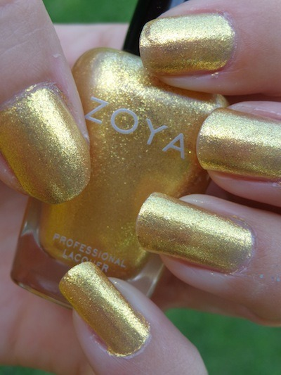 "Zoya ""Kerry"" - a yellow foil with gold and chartreuse glass fleck shimmer.  This is 2 coats.  From the Summer 2013 Irresistible collection."