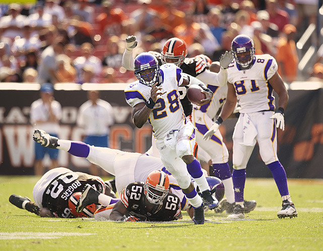 Adrian Peterson busts through the defense during a 2009 Vikings-Browns game. Peterson, as Peter King notes in this week's Monday Morning Quarterback, needs to average 169 yards per game to finish the season in order to break Eric Dickerson's single-season rushing record of 2,105 yards. (Fred Vuich/SI) KING MMQB: Peterson's amazing year and more Week 14 thoughts