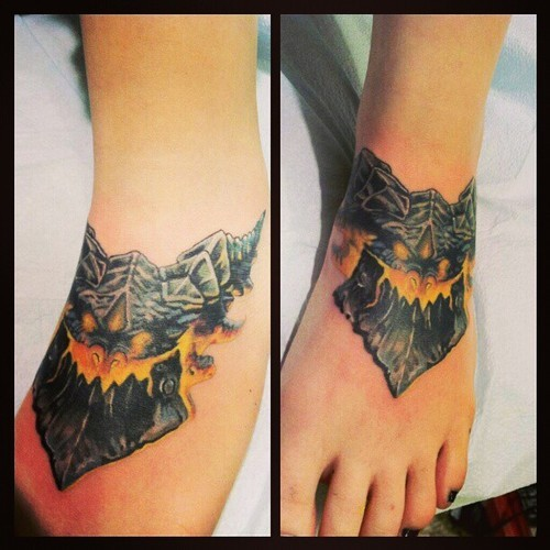 fuckyeahtattoos:  I got Deathwing from World of Warcraft on my foot the other day. The background on it will be done in a few months, I'm still trying to get over how much it hurt. But it was well worth it in my opinion. I've been playing since the game came out, nine years now, and although it's changed dramatically, it will always have a warm place in my heart. Done by Jeffrey Meyer at Unbreakable Tattoo in Studio City, Los Angeles