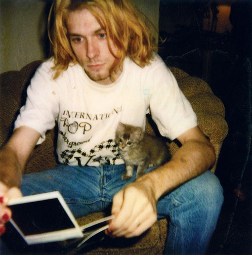 forestsouls:  lawlkitten44:  if you're having a bad day here's Kurt Cobain with a kitten  he looks like and reminds me of cam so much, fuck