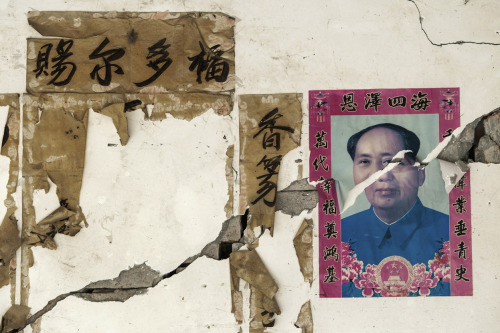 "dig-image:  A portrait of late Chinese Chairman Mao Zedong is torn by cracks on a wall after Saturday's earthquake, in Longxing village, Lushan county, on April 23, 2013. The Chinese characters (L) on the wall read ""Bless you""."