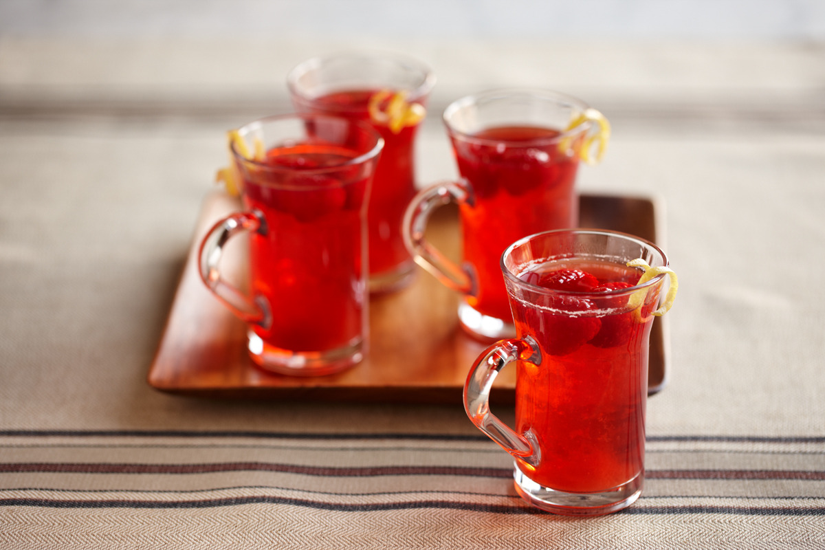 Warm up your winter days with this Hot Spiced Raspberry Cider Recipe! HOT SPICED RASPBERRY CIDER INGREDIENTS 2 packages (6 ounces or 1 1/3 cups) Driscoll's raspberries 4 cups apple cider 4 dashes ground cinnamon 1/2 cups spiced rum Lemon twists, to taste INSTRUCTIONS Set aside 8 to 12 raspberries for garnish. Place apple cider, remaining raspberries and ground cinnamon in a medium saucepan and bring to a boil. Heat until boiling, then let cool. Strain. Stir in spiced rum, if using. Pour Raspberry Cider into coffee mugs. Drop in a lemon twist and garnish with 2 to 4 raspberries per mug. Recipes courtesy of Driscoll's