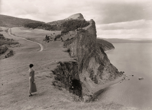 natgeofound:  A woman stands before limestone cliffs in the Gaspe Peninsula, Quebec, September 1934.Photograph by B. Anthony Stewart, National Geographic  That's the hometown all right.