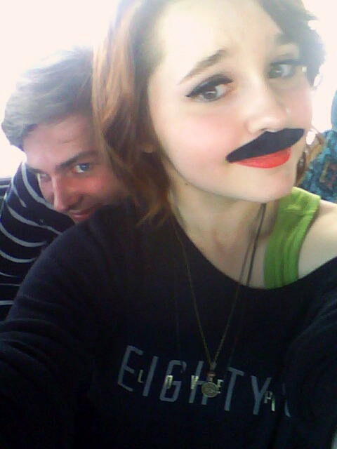 Me with my mustache on the bus trip back home from Festival of Nations, and my friend Ben, being a creeper in the back.