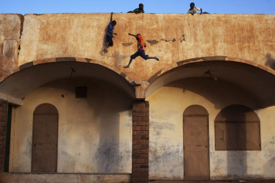 REUTERS/Joe Penney Boys play on the roof of the entrance to a football stadium in Gao - February 20, 2013.