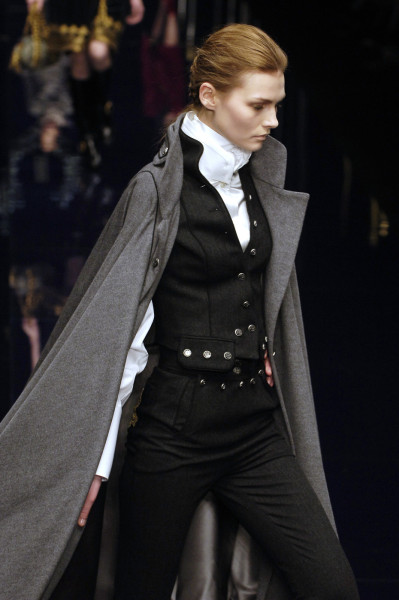 goblinkinginthetardis:  hellotailor:  gaptoothbitch:  DOLCE & GABBANA FW 2006  crying because i'll never be rich enough to afford this perfect outfit.  The Lady Jilli will roll her eyes at how much I'm coveting this (YES I am aware of the impracticality of capes) but sweeping around in this would be decidedly lovely. And that VEST….  Pumpkin, I am NOT rolling my eyes at your coveting, believe me. It's a gorgeous outfit, and I do love capes, no matter how impractical they are.
