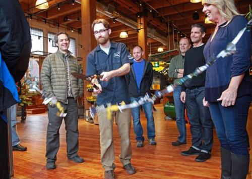 """The ""ribbon"" cut by Keen's store manager was tied together remnants from the company's line of canvas bags."""