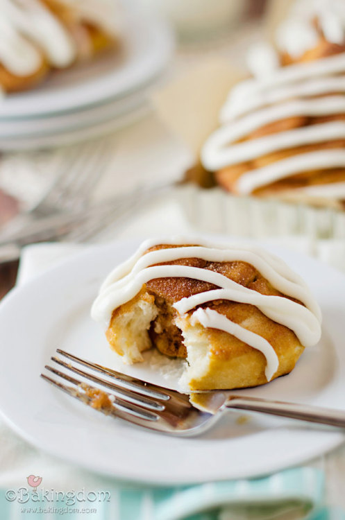 cinnamon roll pretzels with cream cheese frosting.