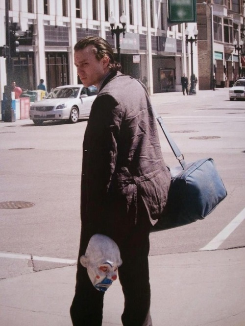 Heath Ledger on set with his Joker mask.