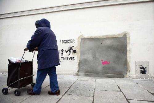 "Residents of London borough Haringey protest the removal of Bansky's ""Slave Labour"" mural from their neighborhood to be sold at a Miami art auction for between $500k and $700k. See the mural, learn more about the pride and inspiration it brought to Haringeyers and about the controversy surrounding its abduction at The Times."