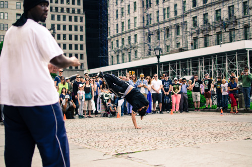 Street performer busting a move near Central Park.