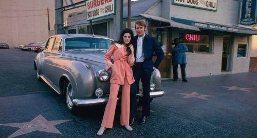bothkindsofmusic:  Bobbie Gentry & Glen Campbell Taken near the Capitol Records building on Vine St off Hollywood Blvd in Los Angeles. That burger stand does not exi