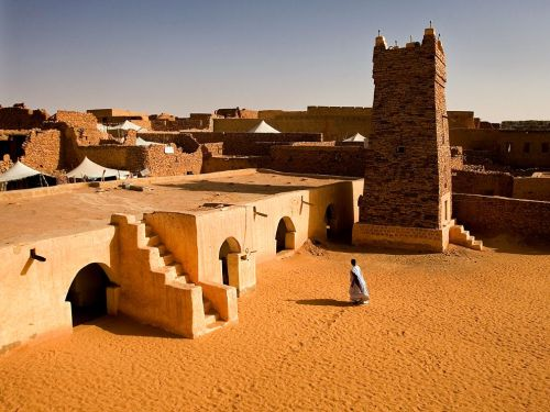 florenceandthenightingale:  Chinguetti Mosque, Mauritania Photograph by David Clifford, 4See/Redux Constructed in the 13th or 14th century, the spare Friday Mosque was the heart of the ancient city of Chinguetti, Mauritania, a vibrant trading center on the trans-Saharan route. The city's original purpose was to provide religious education to travelers, thus the importance of its mosques.