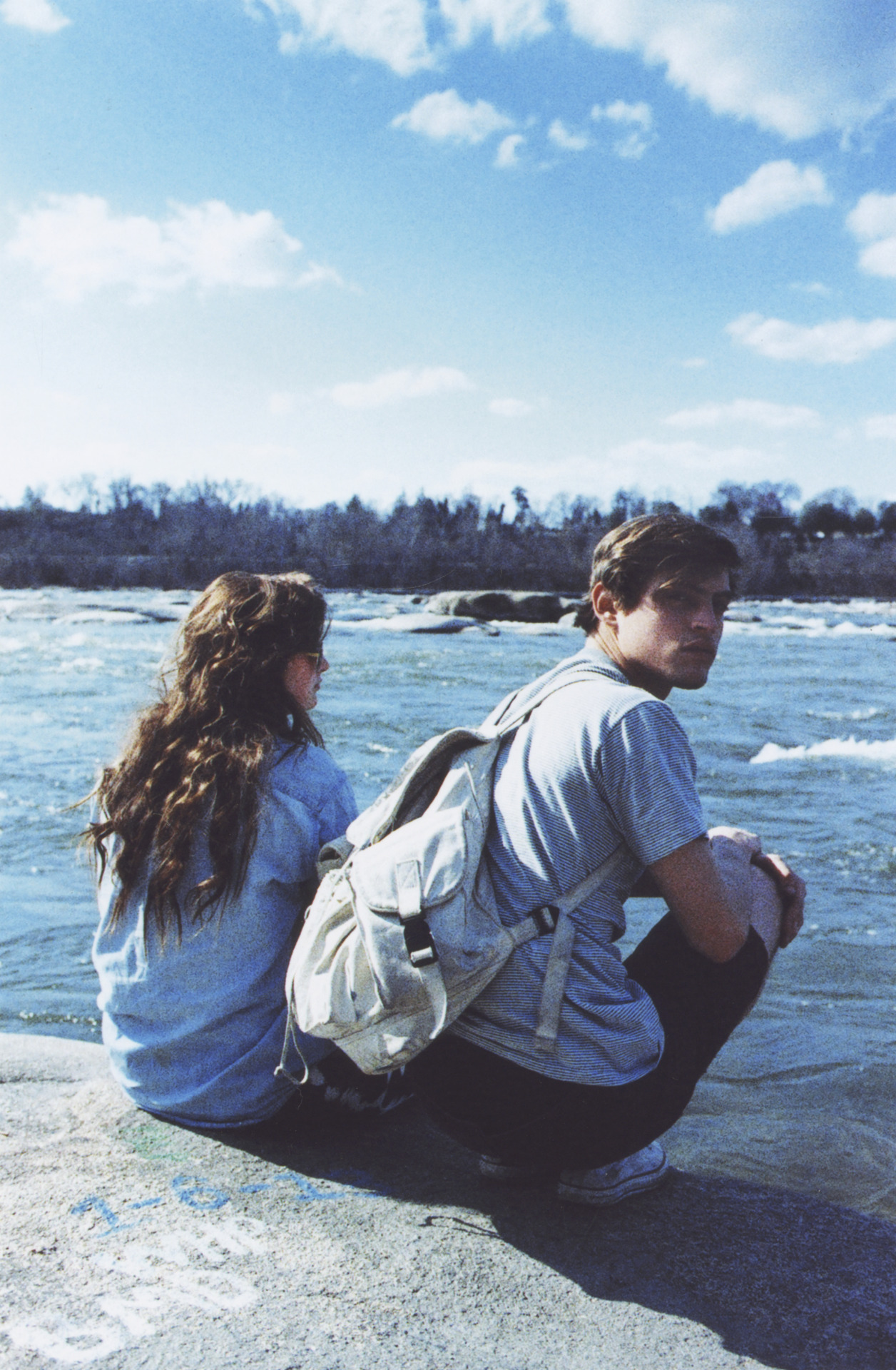 jordantiberio:  M and Andi at the river, Richmond, VA. March 2013.
