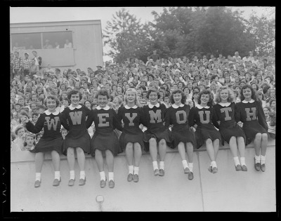 Weymouth High cheerleaders and football game by Boston Public Library on Flickr.