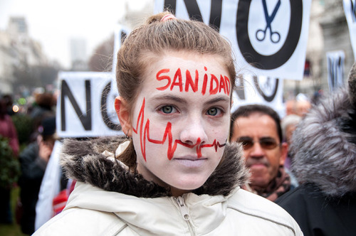 guardian:  Madrid, Spain: a young woman protests against healthcare privatisation Photograph: Lawrence JC Baron/Demotix/Corbis  24 hours in pictures