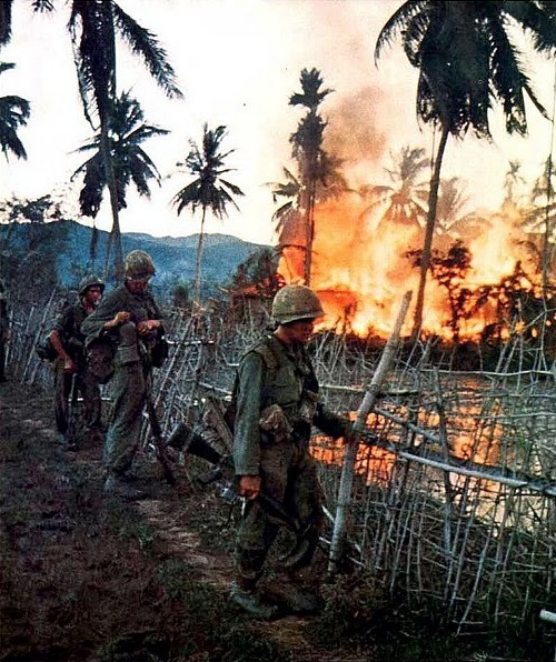 demons:  A Vietnamese village burns after US Marines conducting a search and a destroy mission