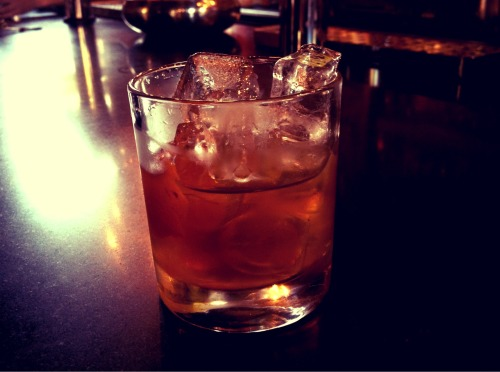 Old fashioned review #100, Trof's Bourbon bar, Manchester NQ   It seemed most appropriate and fitting to the society that we revisit one of our favourite bars and one of our most trusted barman to mark the century milestone of reviews. And so last Thursday evening the General found himself once more dispatched on a mission of vital importance, and before long he was a stumbling up the dancers at Trof on Manchester's Thomas Street, towards the Bourbon Bar in search of Mr Noel and a fine Old Fashioned with which to wet his whiskers. Here is that anniversary drink.  A marvellously mixed old fashioned cocktail employing the smokey and smooth flavours of an Elijah Craig 12 yr Bourbon. THWACK! Wowzer!  9 /10 awarded.   We were first introduced to this powerful concoction in Review #91 at Australasia and boy does it still hit the mark.  With a ripple of applause tumbling from the pavillion, the Society raises its glass and tips its hat to Mr Noel and indeed all the barmen and bar ladies who have provided us with such wonderful and handsome lubrication since our establishment. Naturally, we look forward to the next 100 drinks and providing you our gentlemen members with a balanced and reliable Old Fashioned critique. Hip! Hip!