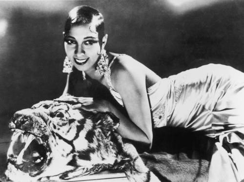 huffiebear:  riskycuriosity:  artemisiumabsinthia:  Josephine Baker, later known as 'Bronze Venus', 'Black Pearl' and 'Créole Goddess' was born in America in 1906 and later moved to France to become a singer, dancer, and actress. She was the first African-American woman to star in a major motion picture, and became famous worldwide. Though she grew up as a maid in wealthy white households she eventually became an exotic dancer in France, famously appearing in next to no clothing, and became a French citizen in 1937.  Ernest Hemingway referred to Baker as 'the most sensational woman anyone ever saw' and she received approximately 1500 marriage proposals in her life time. She became a muse for Hemingway, F. Scott Fitzgerald, Pablo Picasso, and Christian Dior. She had a variety of exotic pets including a cheetah named Chiquita, a chimpanzee named Ethel, a pig named Albert, a snake named Kiki, a goat, a parrot, parakeets, fish, three cats, and seven dogs.  When WWII broke out, Baker became a volunteer spy for France, and assisted the French Resistance by smuggling messages written in invisible ink on sheet music. She made great efforts to aid those in danger of enemy attack, sent Christmas presents to French soldiers, and smuggled information she gathered in Spain back to France by pinning notes containing the information on the inside of her underwear. She was awarded the Medal of Resistance with Rosette and later named a Chevalier of the Legion of Honour.  Baker also aided many civil rights movements by refusing to perform to segregated audiences and storming out of a club in Manhattan with actress Grace Kelly after she was refused service. She worked with the NAACP and spoke at a Washington march alongside Martin Luther King Jr. as the only official female speaker. Baker was actually asked by Martin Luther King Jr.'s widow to take his place as leader of the American Civil Rights Movement, but Baker declined on the grounds her twelve adopted children 'were too young to lose their mother'.  Baker died in 1975, four days after her final show, attended by such names as Mick Jagger, Shirley Bassey, and Liza Minnelli.   Oh and she was queer and had a relationship with Frida Kahlo. All around badass.  Josephine Baker has been one of my favourite people since I was 13 or 14 years old, such an amazingly brave, wonderful person ahh