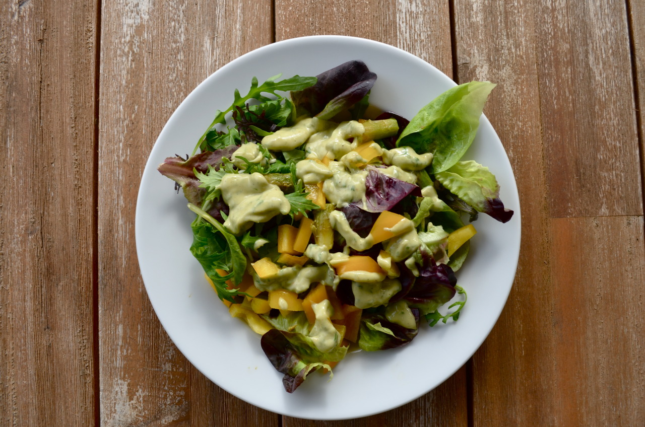 Green salad with yellow bell pepper and avocado lime cashew dressing
