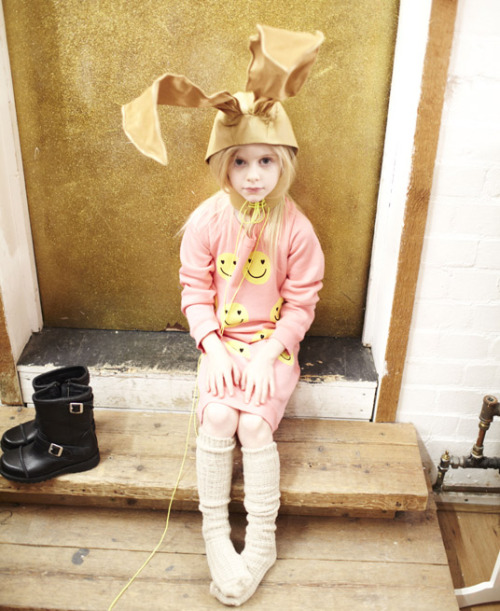 Poppie wears smiley-print jumper dress, £60, Wildfox, and custom-made leather bunny ears, to order, Moody & Farrell, Kids fashion week ARTICLE HERE